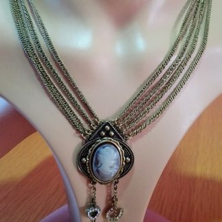 Steampunk lady cameo with good luck charms on a multi chain