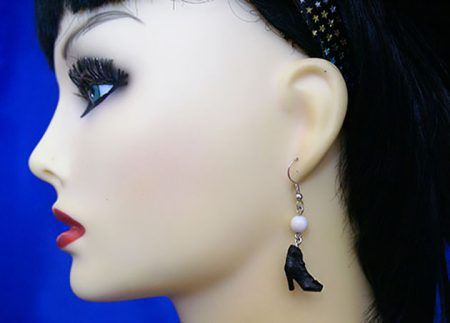 Victorian boot and pearl earrings