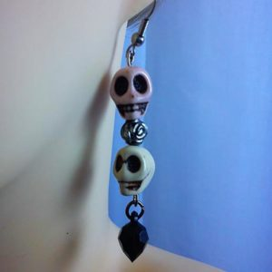 Double skull and bead earrings