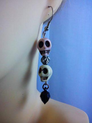 Double skull and bead earrings