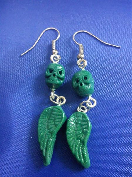 Green skull and drop wing earrings