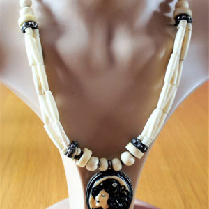 Glow in the dark fantasy lady cameo and cream bead necklace