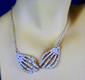 Blood splat 3D skeleton hands necklace