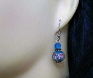 Blue 3D globe with pink flowers earrings