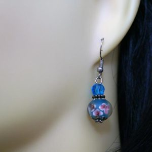 Blue 3D globe with pink flowers earrings