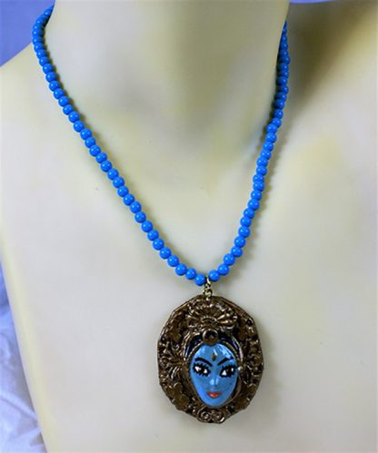 Krishna framed cameo and blue bead necklace
