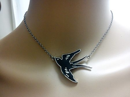Black swallow in flight pendant necklace