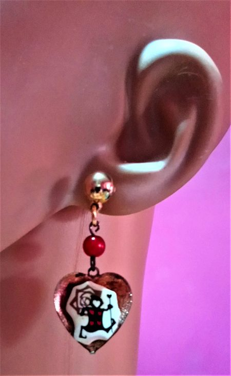 Queen of heart guard and rose cameo heart and bead earrings