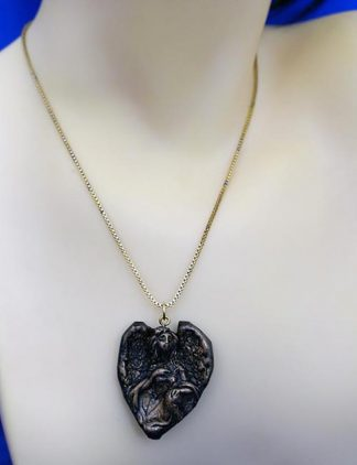 Black and gold 3D angel cameo necklace