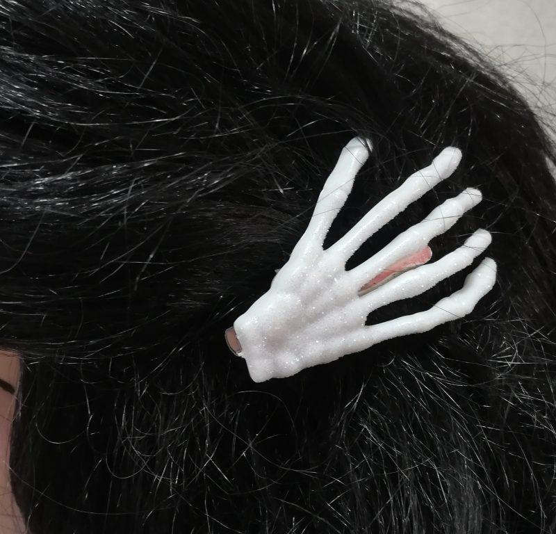 Iridescent skeleton hand hair clips