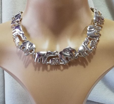 Silver elephant family linked necklace