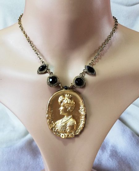 Golden princess cameo and black bead gold chain necklace